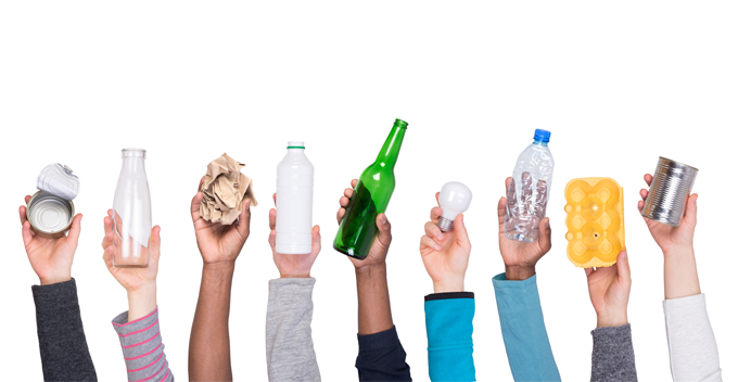 hands holding up garbage and recycling products